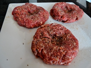 Press thumb into center of patty to prevent burger bloat